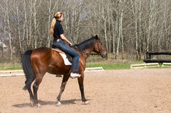 Girl riding on horse stock image