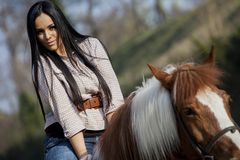 Girl riding on the horse Royalty Free Stock Photography