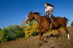 Girl riding a horse Royalty Free Stock Photo