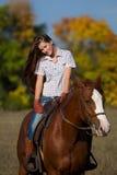 Girl riding a horse Royalty Free Stock Photos