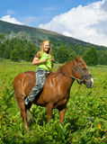 Girl riding a horse bareback Stock Photo