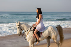 Girl riding horse beach Stock Photo