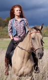 Girl riding horse Stock Photo
