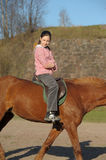 Girl riding on  horse. Girl riding on the brown horse Royalty Free Stock Photos