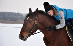 Girl riding on horse Stock Images