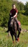 A girl riding a horse at a gallop Stock Photography