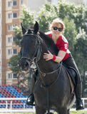 Girl riding a horse Stock Photography