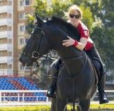 Girl riding a horse Stock Image
