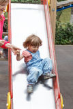 Girl riding at hutches with disheveled hair Royalty Free Stock Photo