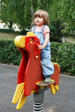 Girl riding at hutches with disheveled hair Stock Photos
