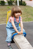 Girl riding at hutches with disheveled hair Royalty Free Stock Photography