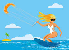 The girl riding the kite in the sea Stock Photography