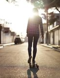 Girl riding on a longboard Royalty Free Stock Photography