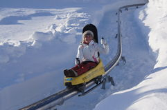 Girl riding Luge Royalty Free Stock Photos