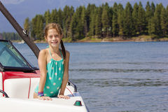 Girl riding a motorboat on a beautiful lake Stock Photo