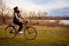 Girl riding old bicycle Stock Photos