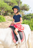 Girl riding pony. Royalty Free Stock Images