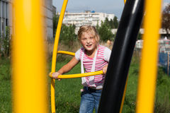 Girl riding rides on a child playground Royalty Free Stock Photo