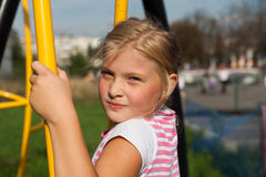 Girl riding rides on a child playground Royalty Free Stock Photography