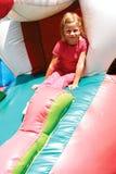 Girl riding a roller coaster Stock Photos