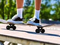 Girl riding on roller skates . Stock Photo