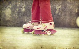 Girl riding on roller skates Royalty Free Stock Photography