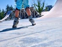 Girl riding on roller skates . Stock Image