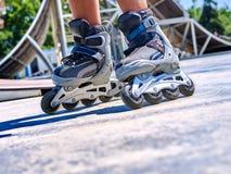 Girl riding on roller skates . Roller skate close up  in skatepark. low section. Children's feet are shod with roller skates Stock Photography