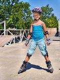 Girl riding on roller skates Royalty Free Stock Image