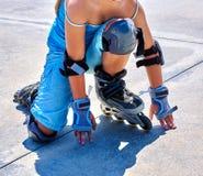 Girl riding on roller skates in skatepark. Stock Image