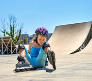 Girl riding on roller skates in skatepark. Stock Image