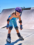 Girl riding on roller skates in skatepark. Royalty Free Stock Images