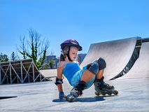Girl riding on roller skates in skatepark. Royalty Free Stock Photo