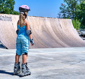 Girl riding on roller skates Stock Photo