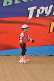 Girl riding on roller skates Stock Image