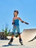 Girl riding on roller skates . Stock Images