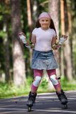 Girl riding rollerblades Royalty Free Stock Image