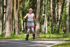 Girl riding rollerblades Royalty Free Stock Photography