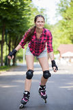 Girl riding rollerblades Stock Photos