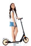 Girl riding a scooter Royalty Free Stock Photos