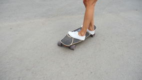 Girl riding on a skateboard stock video footage
