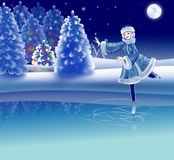 Girl is riding on skating rink. The Fir tree decorated of varicoloured balls is found in the winter forest. The Girl in fur suit ride on skating rink on Royalty Free Stock Photos