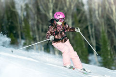 Girl riding on skis royalty free stock images