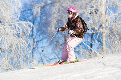 Girl riding on skis Stock Photo