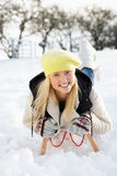 Girl Riding On Sledge In Snowy Landscape Royalty Free Stock Images