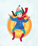Girl riding a snow tube Royalty Free Stock Images
