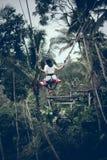 Girl Riding Swing stock photos