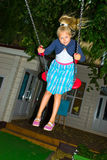 Girl riding on a swing Stock Images