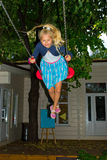 Girl riding on a swing Royalty Free Stock Photo