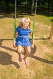 Girl riding on a swing Stock Photos